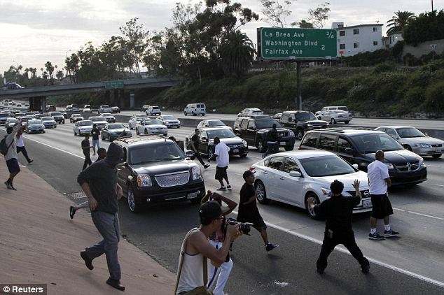 Dangerous: Los Angeles demonstrators began to block traffic on the Interstate 10 freeway while protesting the acquittal of George Zimmerman Sunday