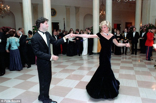 Glamorous: Diana dances with Travolta. She would emerge as a global fashion icon thanks to her Victor Edelstein gown which sold in March for £240,000