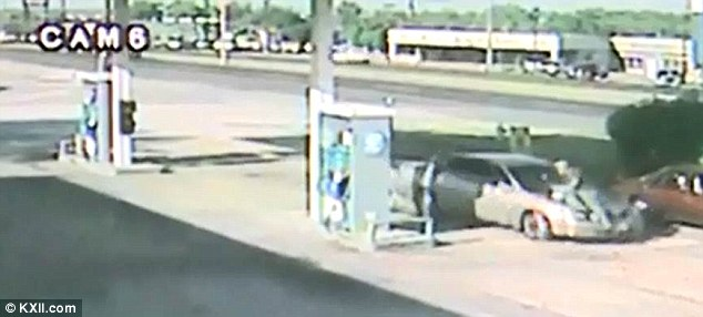 Betty Hernandez was caught on CCTV camera driving into her husband Darrell Elmore at the Mobile station