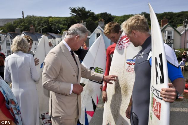 Surf's up: The Prince of Wales chatted with local surfers as he visited Bude as part of Cornwall Week