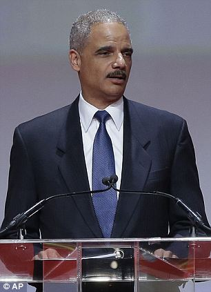 What's next: Attorney General Eric Holder (right) said that the Justice Department will continue their civil investigation into whether or not the killing of Martin (left) was a hate crime