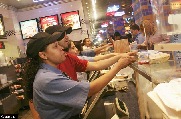 Hard day's work: According to the sample budget, a minimum-wage fast food worker would need to get a second job and work over 60 hours a week to survive