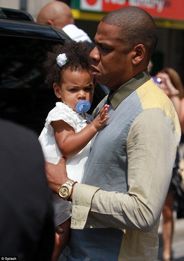 Just like daddy: Blue Ivy was the spitting image of her father as they stepped out to lunch with Beyonce at Nervosa Trattoria Italian Restaurant in Toronto on Wednesday