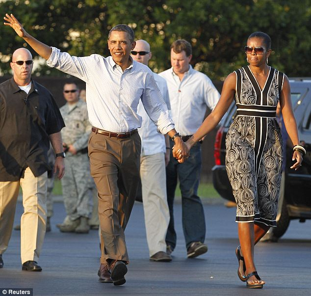 Rest and relaxation: Barack Obama and first lady Michelle Obama walk to Air Force One returning to Washington after their Christmas and New Year vacation in Hawaii in 2012