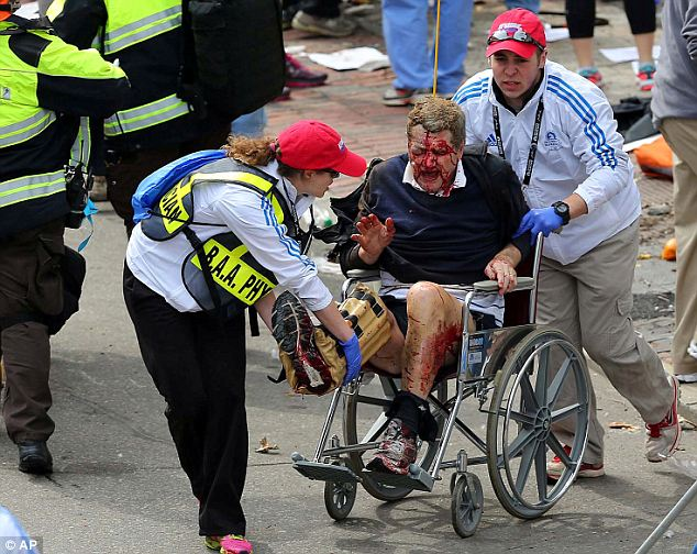 Traumatic: Unlike many victims who were at the scene (pictured) and lost limbs, Ms Gause falsely claimed that she was treated at hospitals in Boston and in New York for a traumatic brain injury suffered in the bombings