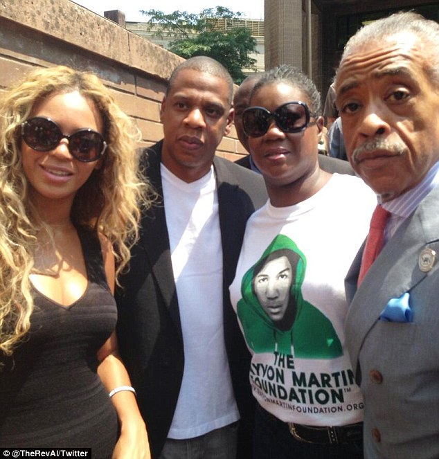 High profile: Trayvon's mother Sybrina Fulton, third from left, was joined by Beyonce, Jay Z and the Rev Al Sharpton at New York's protest Saturday