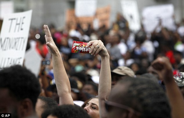 Icon: Members of the crowd wore hoodies or held up packets of Skittles in reference to Trayvon being shot as he returned from buying the candy