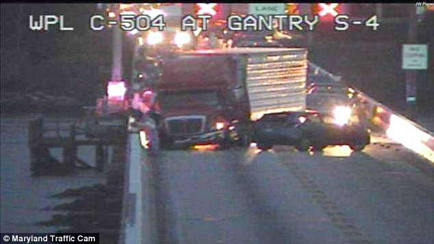 Pushed off: Traffic cam footage from Friday night shows the tractor trailer that forced the car off the bridge and into the bay below