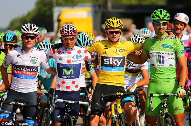 Colourful: Chris Froome looks resplendent in yellow, alongside second placed best young rider and King of the Mountain Nairo Quintana (second left) and winner of the Green Jersey Points Classification Peter Sagan (right). Sagan shows off his green beard