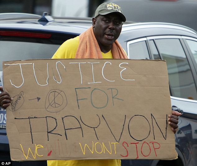 Pro-Trayvon: A protestor carries a sign in the River Oaks community in Houston on Sunday