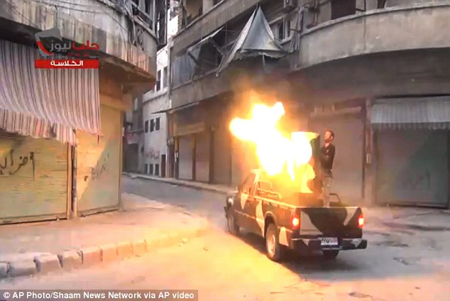 Fighters from the Free Syrian Army targets one of the bastions of the regimeís forces in Aleppo, Syria