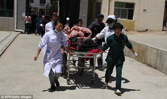 More than 400 people were injured and 56 people died during the shallow quake in China. Many patients were treated in hospital at Minxian county (pictured) in northwest China's Gansu province