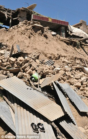 Homes were reduced to rubble in Meichuan Town, Minxian County, Gansu Province, after the shallow quake which measured up to a magnitude 6.6