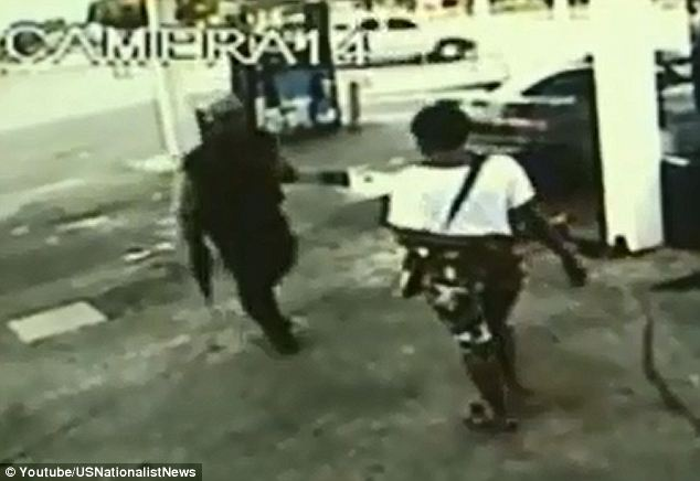 Verbal altercation: The female shooter, seen here in camouflage shorts, approaches Lewis Daniels
