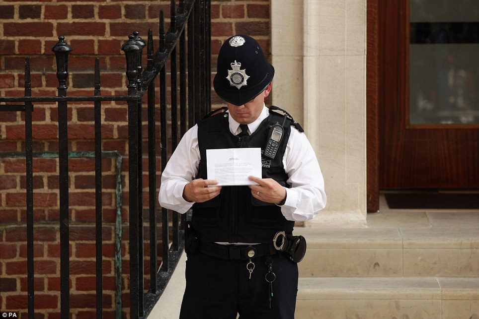 Bungle: A police officer, standing on the steps of the Lingo Wing at St Mary's Hospital, shows off a confidential briefing note in full view of the world's media