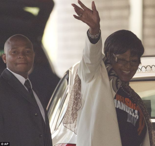 Happy: Family members and friends have visited Nelson Mandela in hospital today as South Africa celebrates the former president's 95th birthday. His former wife Winnie Madikizela-Mandela, right, waves to the well wishers at the hospital