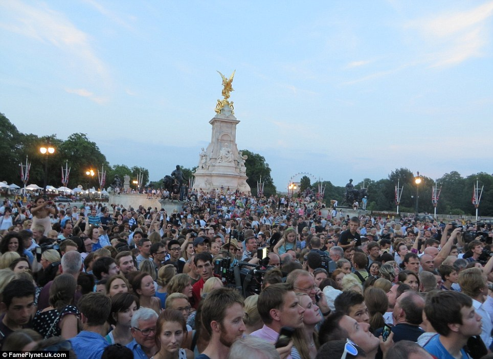 Iconic: Crowds climb the Victoria memorial to try and get a better view