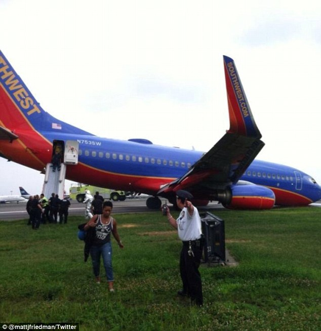 Passengers ran to safety after evacuating the crippled jetliner on Monday evening