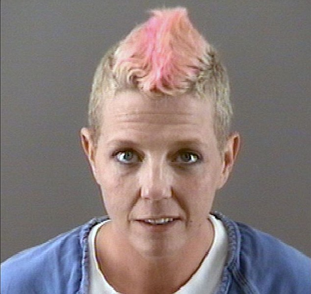 Exposed: Gustwiller, pictured in her police mugshot sporting her mohawk, claimed that she was battling addiction when she made up the cancer lie