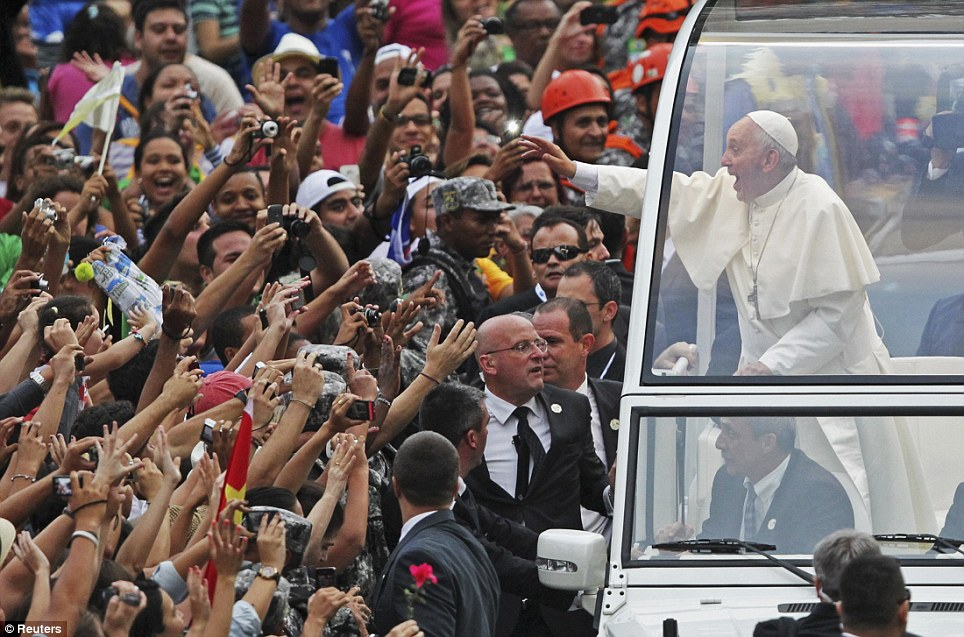 Crowds of the faithful: Pope Francis looked thrilled at the reception he was given in Rio de Janeiro, reaching out to greet those who had flocked to see him