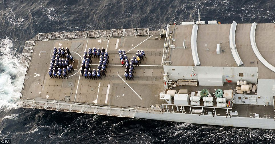 On the high seas: Sailors on HMS Lancaster posed up in the shape of the word 'BOY' for this aerial photograph