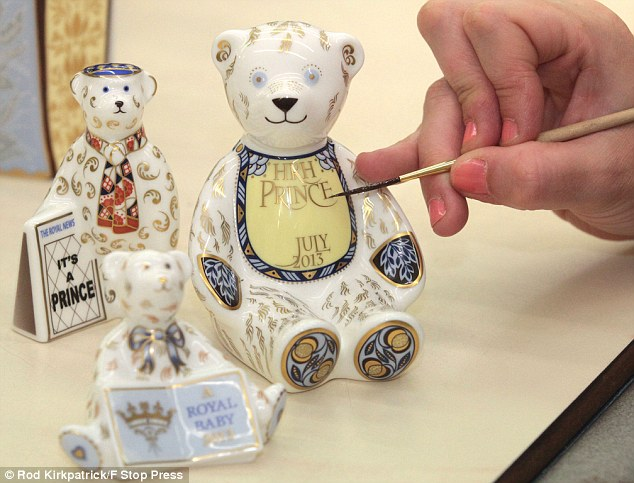 Finishing touches: Hand-painted teddy bears which are part of the Royal Crown Derby's Royal Birth collection which will go on sale within days. Staff worked through the night on the products