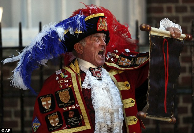Not the Royal Deal: Tony Appleton, a town crier, announces the birth of the royal baby, outside St. Mary's Hospital exclusive Lindo Wing in London