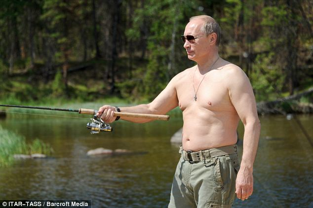 Topless: Russia's president Vladimir Putin went topless during a fishing trip to a national nature reserve in Tuva, Russia