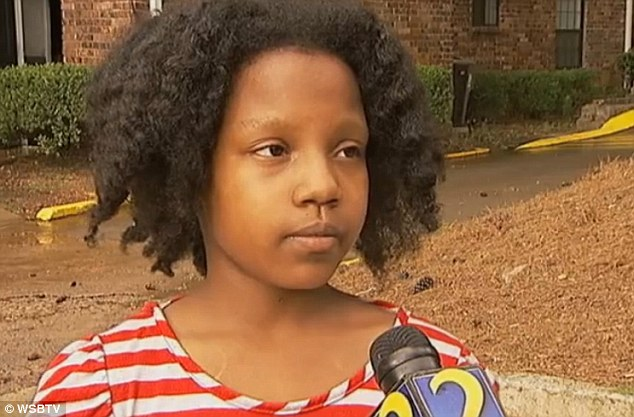 Local hero: Zna Gresham is being hailed as a hero for catching the baby, one of three young children dropped from the window Thursday at the Arbors at North Decatur in the Atlanta suburb of Decatur