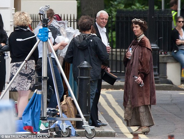 Time out: Members of the Downton cast chatted as they took a water break in between takes