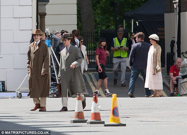 Turning back time: Swapping the green fields of the fictional Downton estate in Yorkshire for the busy streets of the capital, the cast of the show could have easily stepped straight out of the 20s