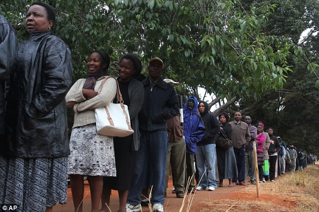 Queue: Voters in the suburbs of Harare line up to have their say in the crunch election