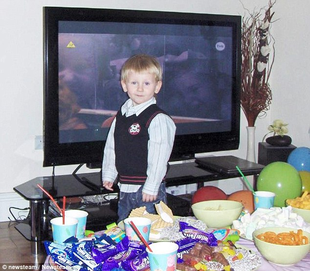 Starved Daniel Pelka pictured next to a pile of food was starved in the months before he died and was severely malnourished