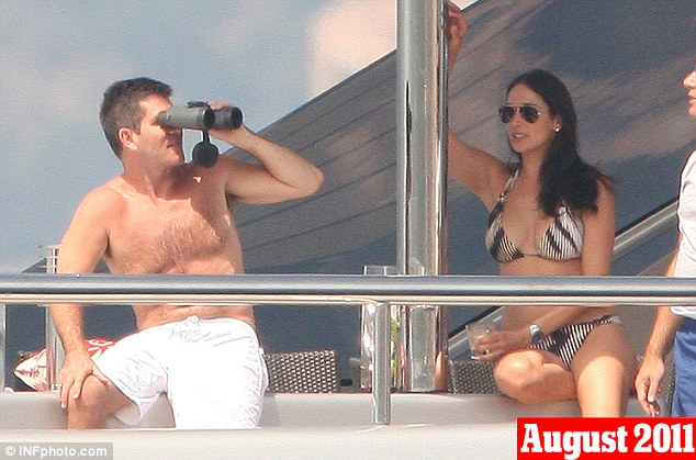 August 4th, 2011: Cowell and Lauren are seen on holiday together in St Tropez, where they were joined by his close friend Sinitta