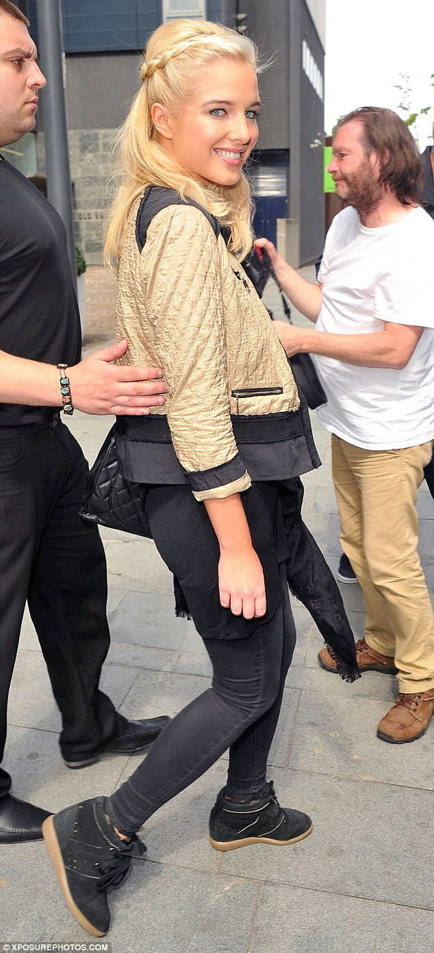 Black and gold: Helen threw a quilter bomber jacket over the cheeky t-shirt as she left the spa for the day