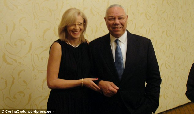 Corina Cretu (left) is pictured with Colin Powell (right) at a conference in Washington in July 2011. She posted this photo to her blog