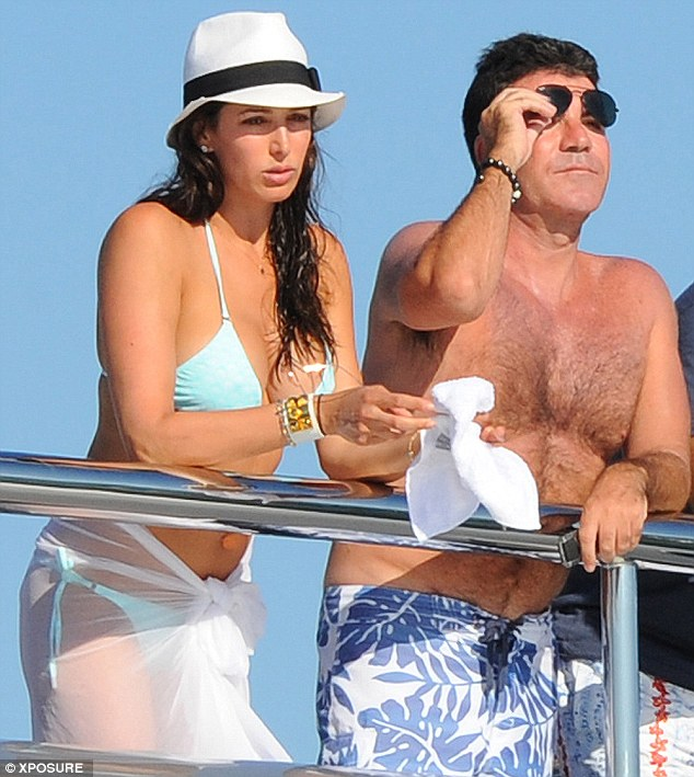 Holiday buddies: Simon Cowell and his now pregnant lover Lauren Silverman were pictured together in St Tropez in August 2012. Images on TMZ.com from the same break appear to show the pair kissing