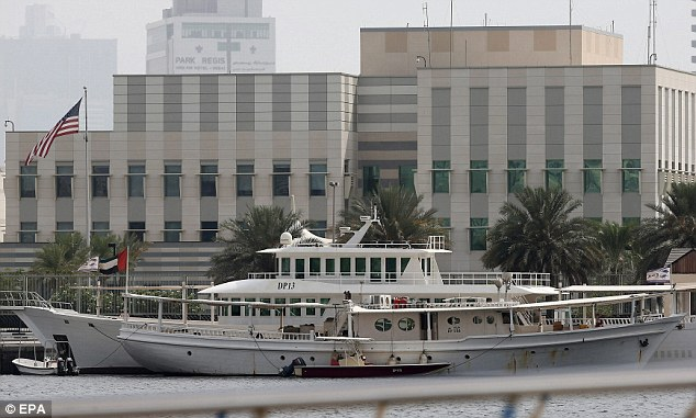 Boats are seen in front of the U.S. consulate building in Gulf emirate of Dubai, United Arab Emirates, on August 3