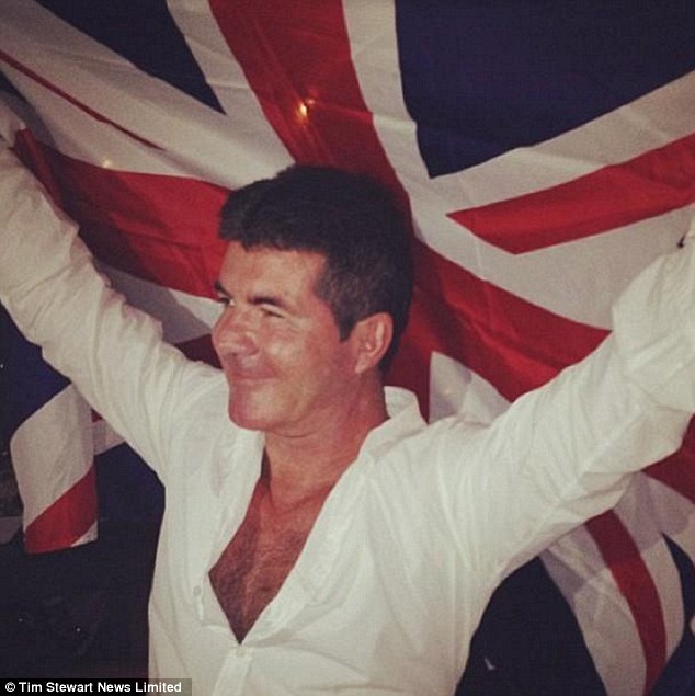 Vacation: Lauren posted a picture of Cowell holding up a Union flag during their holiday to St Barts in January