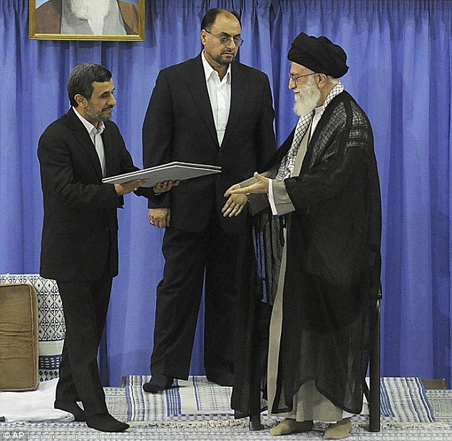 In this picture released by the Iranian supreme leader's office, outgoing president Mahmoud Ahmadinejad hands back the official seal of approval to Ayatollah Ali Khamenei
