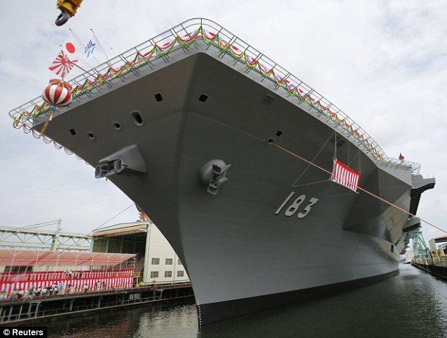 Beratap datar: Namun para pejabat bersikeras kapal tidak sebuah kapal induk dan tidak akan digunakan untuk meluncurkan pesawat