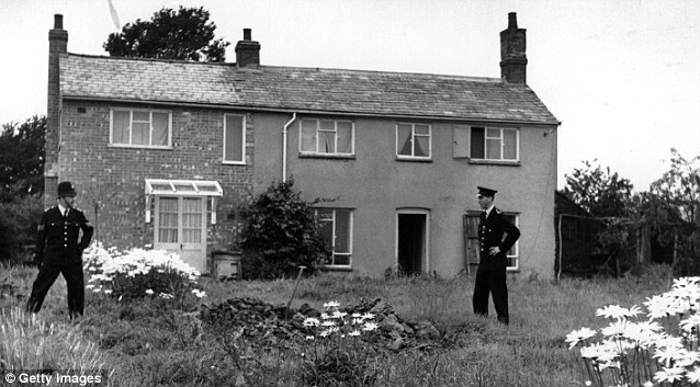 Breakthrough: Police stand guard outside Leatherslade Farm at Oakley in Buckinghamshire, used as a hide-out by the Great Train Robbers