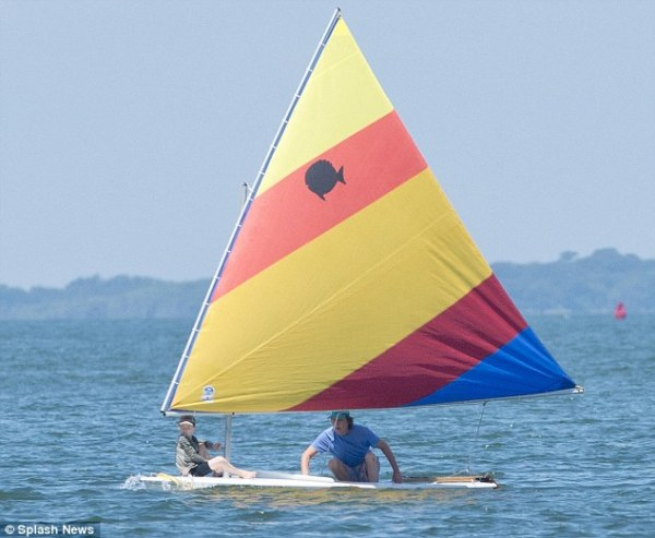 Paul McCartney sets sail in child sized dinghy in the