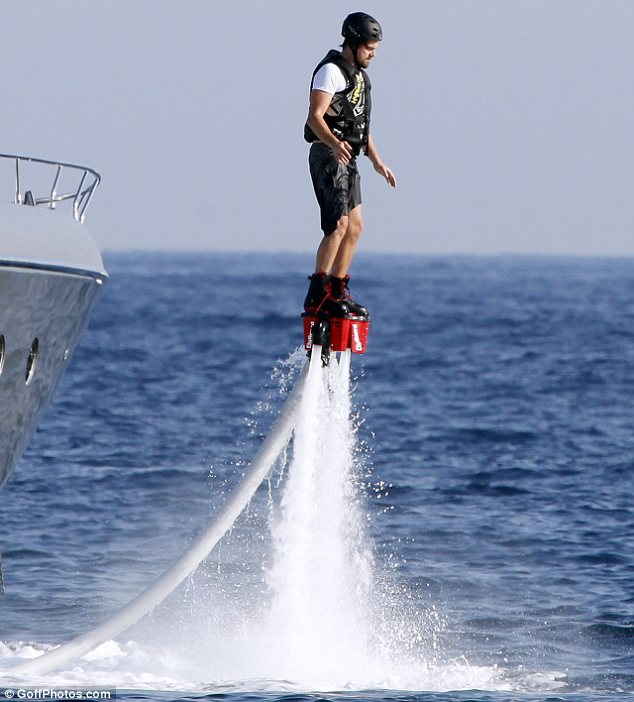 Thrill-seeker: Leonardo DiCpario was seen propelling himself into the air, thanks to a pair of jet pack shoes in the sea in Ibiza on Wednesday
