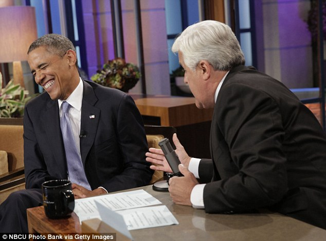 Time for a laugh: Obama grins during a commercial break while filming The Tonight Show on Tuesday