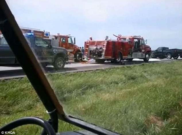 Scene: Dozens of emergency workers battled to free Katie Lentz as she lay pinned in her Mercedes wreck on Highway 19