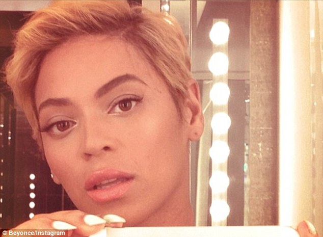 Bold new look: Beyonce shared a snapshot of her cropped hairstyle on Wednesday after removing her weave and cutting her remaining hair into this edgy new style