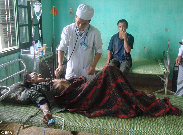 Check-up: A doctor monitors Thanh, who has seen no one except his son for the past four decades