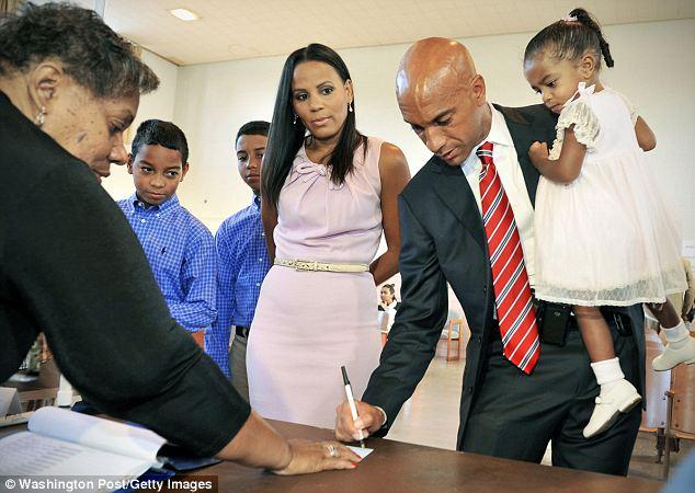 steve jobs widow dating a black man
