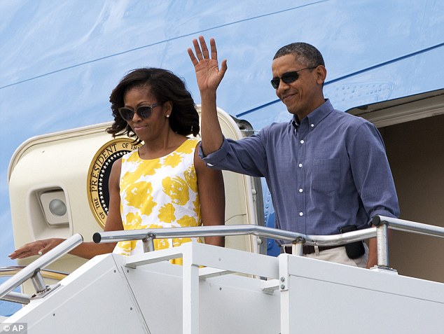 Hello vacation time: Looking more comfortable the President traded his suit for a button down and pair of khakis, while the first lady removed her proper pearls